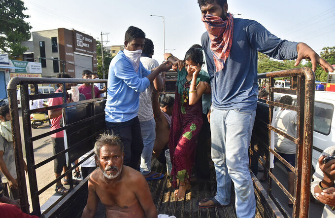 People affected by a chemical gas leak are carried out of a truck to an ambulance in Vishakhapatnam, India, Thursday, May 7, 2020. Chemical gas leaked from an industrial plant in southern India early Thursday, leaving people struggling to breathe and collapsing in the streets as they tried to flee. Administrator Vinay Chand said several people fainted on the road and were rushed to a hospital. (AP Photo)