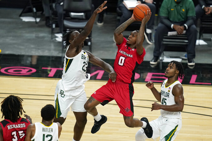 Louisiana-Lafayette's Cedric Russell (0) shoots over Baylor's Jonathan Tchamwa Tchatchoua (23) during the first half of an NCAA college basketball game Saturday, Nov. 28, 2020, in Las Vegas. (AP Photo/John Locher)