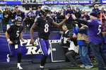 FILE - In this Dec. 30, 2018, file photo, Baltimore Ravens quarterbacks Lamar Jackson (8) and Joe Flacco (5) run onto the field before an NFL football game against the Cleveland Browns, in Baltimore.  A person with knowledge of the trade tells The Associated Press, Wednesday, Feb. 13, 2019, that the Denver Broncos have agreed to acquire Baltimore Ravens quarterback Joe Flacco in exchange for a fourth-round pick in this year's NFL draft. The person spoke on condition of anonymity because neither team announced the deal. Flacco became expendable in Baltimore with the emergence of rookie Lamar Jackson. (AP Photo/Nick Wass, File)