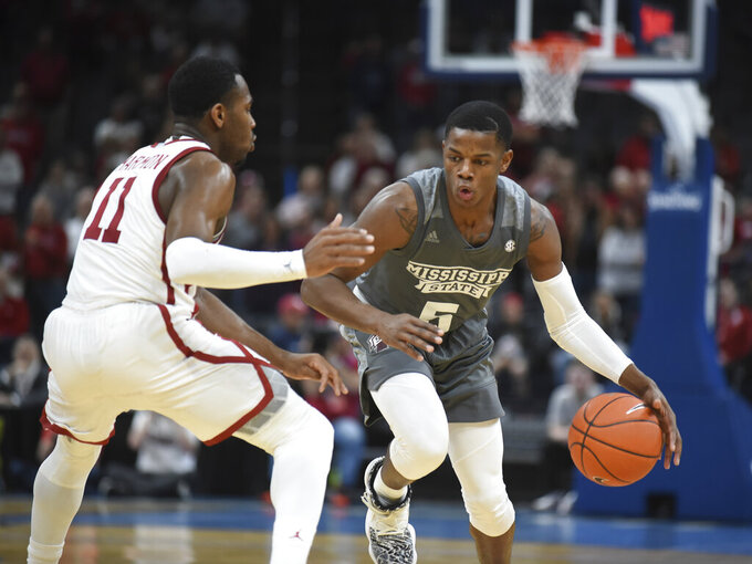 Mississippi State guard Iverson Molinar (5) looks for an opening past Oklahoma guard De'Vion Harmon (11) during the second half of an NCAA college basketball game in Oklahoma City, Saturday, Jan. 25, 2020. (AP Photo/Kyle Phillips)