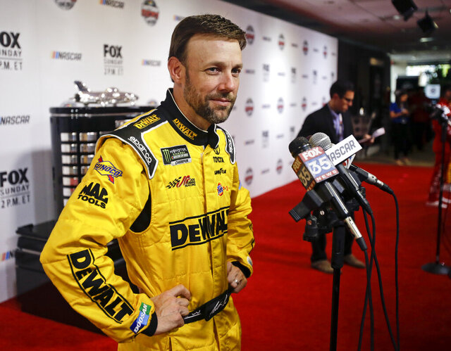 FILE - In this Feb. 22, 2017, file photo, Matt Kenseth answers questions during NASCAR Daytona 500 media day at Daytona International Speedway in Daytona Beach, Fla. Former NASCAR champion Matt Kenseth will once again come out of retirement to compete for Chip Ganassi Racing as the replacement for fired driver Kyle Larson. Larson lost his job two weeks ago for using a racial slur while competing in a virtual race.  (AP Photo/John Raoux, File)