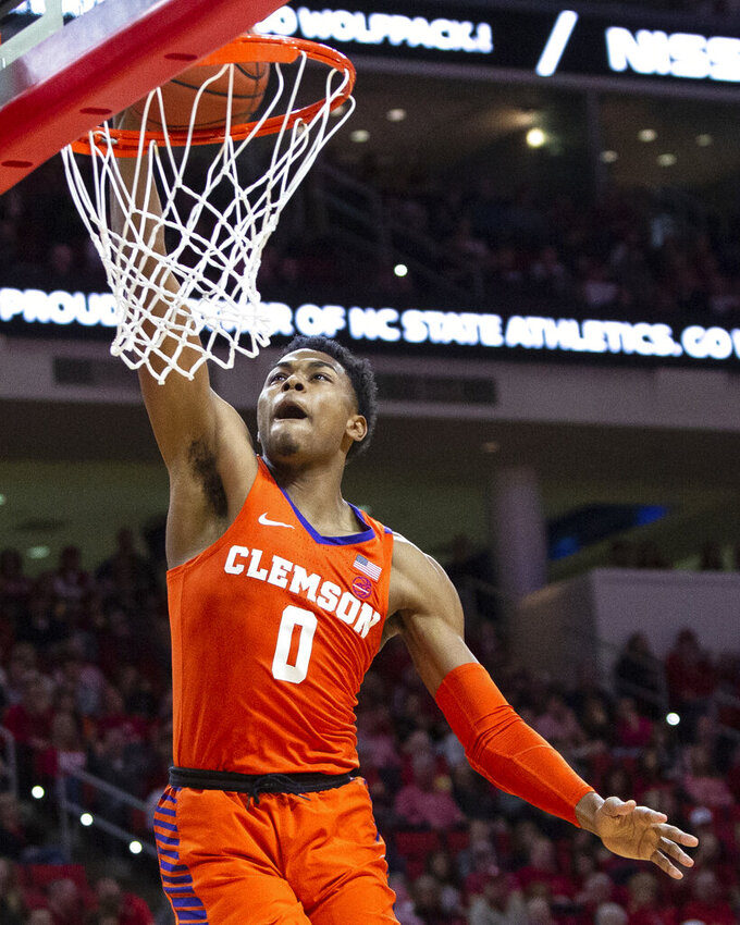 Clemson's Clyde Trapp (0) dunks during an NCAA college basketball game against North Carolina State in Raleigh, N.C., Saturday, Jan. 26, 2019. (AP Photo/Ben McKeown)