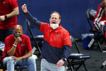 Mississippi head coach Kermit Davis yells to his players in the first half of an NCAA college basketball game against LSU in the Southeastern Conference Tournament Friday, March 12, 2021, in Nashville, Tenn. (AP Photo/Mark Humphrey)