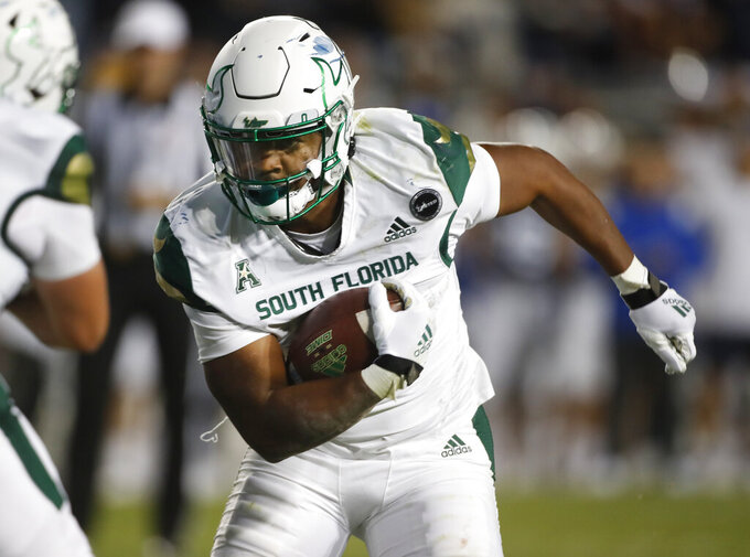 South Florida running back Jaren Mangham (0) runs for a touchdown in the second half of an NCAA college football game against BYU Saturday, Sept. 25, 2021, in Provo, Utah. (AP Photo/George Frey)