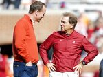 Alabama head coach Nick Saban talks with former Tennessee quarterback Peyton Manning before an NCAA college football game, Saturday, Oct. 20, 2018, in Knoxville, Tenn. (AP Photo/Wade Payne)