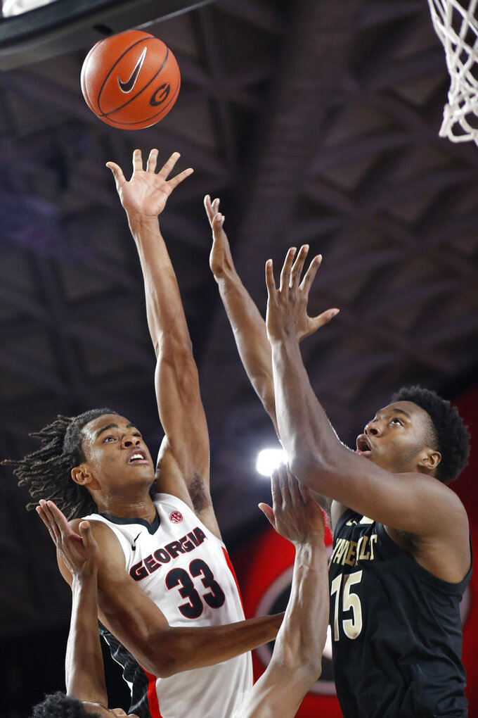 Georgia forward Nicolas Claxton (33) takes a shot while being defended by Vanderbilt forward Aaron Nesmith (24) and Vanderbilt forward Clevon Brown (15) during an NCAA college basketball game, Wednesday, Jan. 9, 2019 in Athens, Ga. (Joshua L. Jones/Athens Banner-Herald via AP)