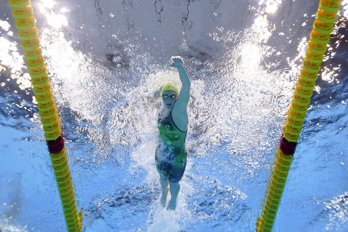 Australia's Ariarne Titmus competes in a 400-meter freestyle heat at the 2020 Summer Olympics, Sunday, July 25, 2021, in Tokyo. (AP Photo/David J. Phillip)