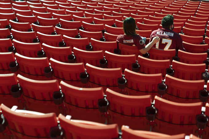 Fans take their seat at FedEx Field before the start of an NFL football game between the New York Giants and Washington Football Team, Sunday, Nov. 8, 2020, in Landover, Md. (AP Photo/Patrick Semansky)