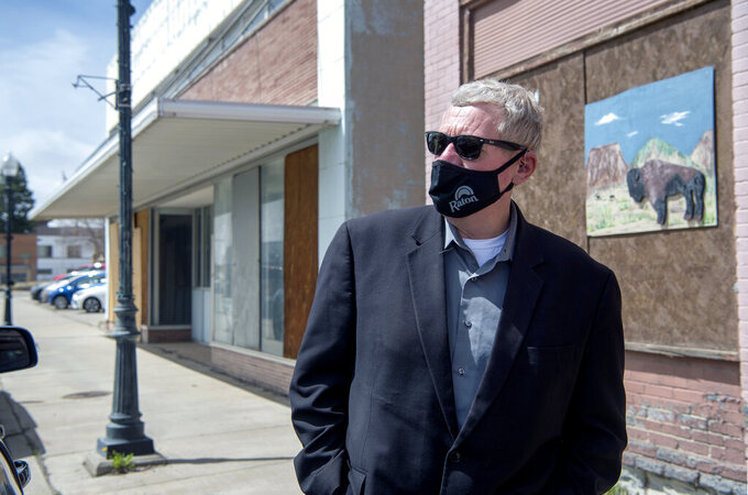Raton City Manager Scott Berry is photographed downtown on Tuesday, April 27, 2021 in Raton, N.M.  Vacant buildings — some dilapidated and others that look recently abandoned — have become an unavoidable reality in Raton, a constant reminder to residents of their town's current plight. (Eddie Moore /The Albuquerque Journal via AP)