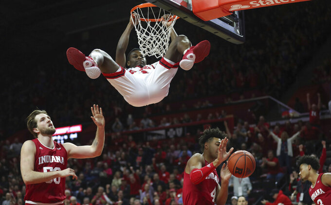 Rutgers guard Montez Mathis (23) hangs on the rim after this slam dunk during the first half of an NCAA college basketball game against Indiana, Wednesday, Jan. 15, 2020 in Piscataway, N.J. (Andrew Mills/NJ Advance Media via AP)
