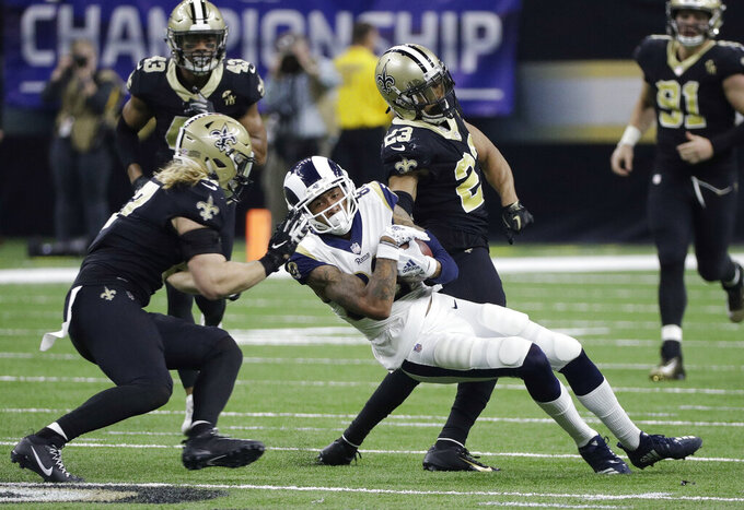 Los Angeles Rams' Josh Reynolds catches a pass in front of New Orleans Saints' Alex Anzalone during the second half of the NFL football NFC championship game, Sunday, Jan. 20, 2019, in New Orleans. (AP Photo/David J. Phillip)