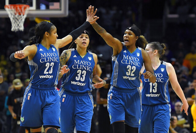 FILE - In this Oct. 16, 2016, file photo, members of the Minnesota Lynx, from left, Maya Moore, Seimone Augustus, Rebekkah Brunson and Lindsay Whalen celebrate during the second half in Game 4 of the WNBA Finals against the Los Angeles Sparks in Los Angeles. Augustus has left the Lynx after 14 seasons to join the Los Angeles Sparks. The All-WNBA guard Augustus was a key piece of four championship teams in Minnesota, which drafted her with the first overall pick out of LSU in 2006. With Moore on hiatus from the sport and Whalen and Brunson retired, the Lynx are in rebuilding mode.(AP Photo/Mark J. Terrill, File)