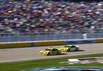 Joey Logano (22) and Ryan Blaney (12) drive during a NASCAR Cup Series auto race at the Las Vegas Motor Speedway on Sunday, Feb. 23, 2020. (AP Photo/Chase Stevens)
