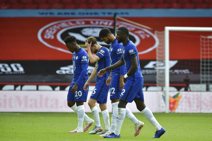 Chelsea players leave the field end of the English Premier League soccer match between Sheffield United and Chelsea at Bramall Lane in Sheffield, England, Saturday, July 11, 2020. Sheffield United won 3-0. (AP photo/Rui Vieira, Pool)