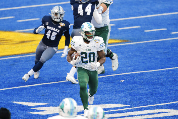 Tulane running back Cameron Carroll (20) breaks away from the Nevada defense for a touchdown late in the second half of the Famous Idaho Potato Bowl NCAA college football game Tuesday, Dec. 22, 2020, in Boise, Idaho. (AP Photo/Steve Conner)