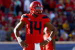 Arizona quarterback Khalil Tate (14) looks on in the second half during an NCAA college football game against Arizona State, Saturday, Nov. 24, 2018, in Tucson, Ariz. Arizona is looking for more consistency after a disappointing first season under coach Kevin Sumlin. The Wildcats return several key players, led by quarterback Khalil Tate and running back J.J. Taylor. Arizona opens its season playing at Hawaii on Aug. 24. (AP Photo/Rick Scuteri)