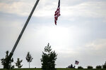 A member of the Patriot Guard Riders makes their way in for the committal ceremony for Marine Cpl. Daegan Page at the Omaha National Cemetery on Friday, Sept. 17, 2021, in Omaha, Neb. Cpl. Page was killed by a suicide bomber Aug. 26 in Afghanistan during the evacuation from the United States' 20-year war. (Chris Machian/Omaha World-Herald via AP)