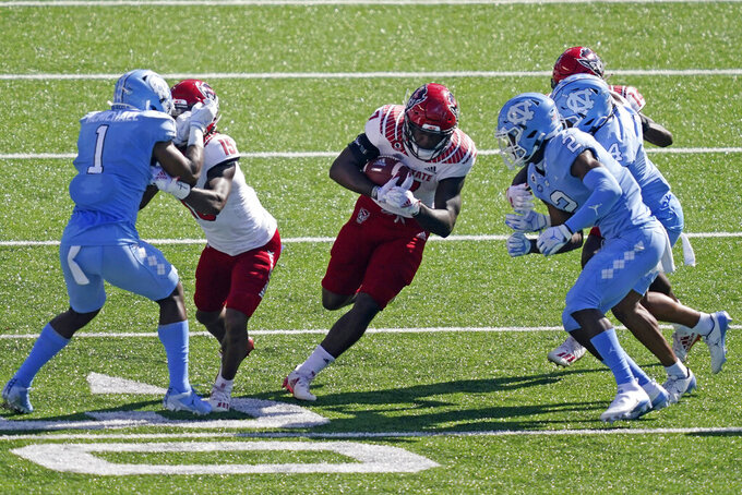 North Carolina State running back Zonovan Knight (7) finds some running room against North Carolina during the first half of an NCAA college football game in Chapel Hill, N.C., Saturday, Oct. 24, 2020. (AP Photo/Gerry Broome)