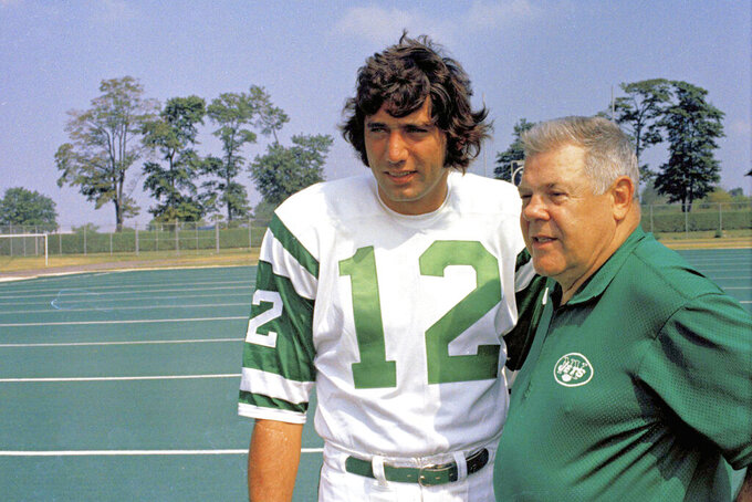 FILE - This is an undated photo showing Joe Namath, left, quarterback for the New York Jets, talking with head coach Weeb Ewbank during football practice session in 1970. As part of its celebration of its 100th season, the NFL is designating a Game of the Week, each chosen to highlight a classic matchup. For Week 2, it is the Monday night game between the Browns and Jets.  Joe Namath and Leroy Kelly were supposed to be the offensive stars in the inaugural game of pro football's prime-time telecasts. But the guys who moved the ball best were the guys in the striped shirts. The guys in the striped shirts _ the officiating crew headed by Norm Schacter _ moved the ball so well that they played a key role in Cleveland's 31-21 victory and may have played a key role in the important ratings battle against Liz, Dick and Lucy.(AP Photo/File)