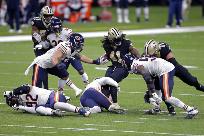 New Orleans Saints running back Alvin Kamara (41) carries for a first down in the first half of an NFL wild-card playoff football game against the Chicago Bears in New Orleans, Sunday, Jan. 10, 2021. (AP Photo/Brett Duke)