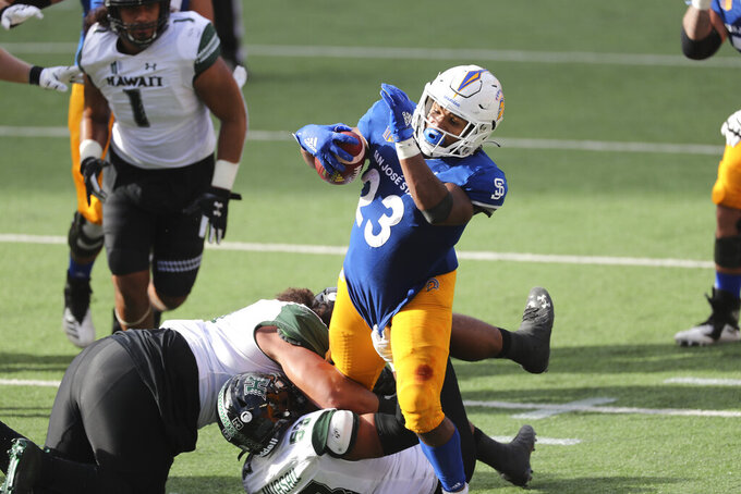 San Jose State running back Tyler Nevens (23) runs through the Hawaii defense during the second half of an NCAA college football game Saturday, Dec. 5, 2020, in Honolulu. (AP Photo/Marco Garcia)