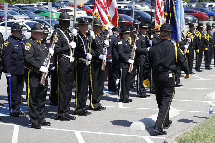 An honor guard made up of corrections officers from various states attends the funeral for Tennessee Department of Correction administrator Debra Johnson Friday, Aug. 16, 2019, in Nashville, Tenn. Officials say inmate Curtis Watson killed Johnson before his escape from the West Tennessee State Penitentiary Aug. 7. (AP Photo/Mark Humphrey)