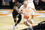 Vanderbilt guard Maxwell Evans (3) and Tennessee's Santiago Vescovi (25) chase the ball during an NCAA college basketball game at Thompson-Boling Arena in Knoxville, Tenn., Saturday, Jan. 16, 2021. (Calvin Mattheis/Knoxville News Sentinel via AP, Pool)