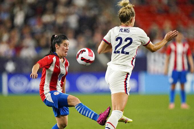 Paraguay midfielder Fanny Godoy (10) works against U.S. midfielder Kristie Mewis (22) during the first half of an international friendly soccer match Thursday, Sept. 16, 2021, in Cleveland. (AP Photo/Tony Dejak)