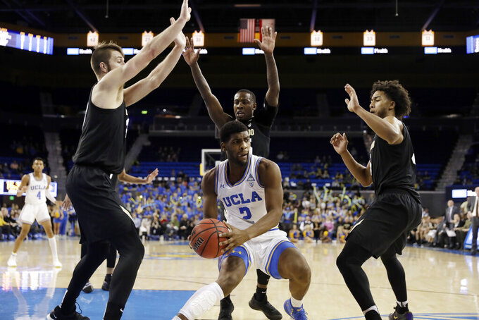 UCLA forward Cody Riley (2) is surrounded by Colorado defenders during the second half of an NCAA college basketball game Wednesday, Feb. 6, 2019, in Los Angeles. (AP Photo/Marcio Jose Sanchez)