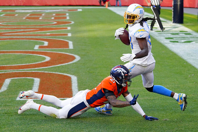 Los Angeles Chargers wide receiver Mike Williams (81) pulls in a touchdown pass as Denver Broncos cornerback A.J. Bouye (21) defends during the second half of an NFL football game, Sunday, Nov. 1, 2020, in Denver. (AP Photo/David Zalubowski)