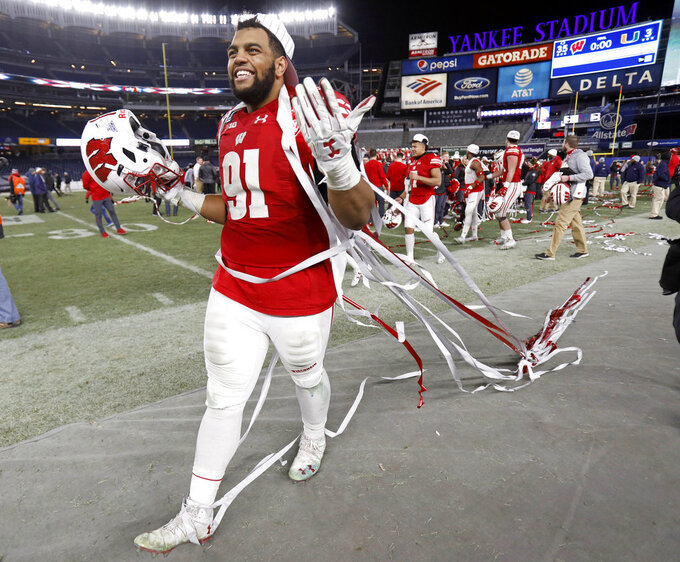 Wisconsin nose tackle Bryson Williams (91) celebrates after Wisconsin defeated Miami 35-3 in the Pinstripe Bowl NCAA college football game Thursday, Dec. 27, 2018, in New York. (AP Photo/Adam Hunger)