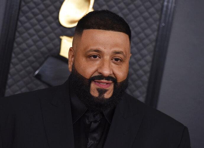 """FILE - This Jan. 26, 2020 file photo shows DJ Khaled at the 62nd annual Grammy Awards in Los Angeles. Khaled, Charlie Wilson, Chance the Rapper, Kirk Franklin, Fantasia, Melvin Crispell III will perform in a special BET show that will assist people of color deal with the coronavirus. The """"Saving Our Selves: A BET COVID-19 Relief Effort"""" broadcast special, will air on April 22 at 8 p.m. EST.  (Photo by Jordan Strauss/Invision/AP, File)"""