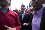 CORRECTS SPELLING OF GUAIDO - Venezuela's self-proclaimed interim president Juan Guaido walks into the crowd after he addressed transportation workers during a demonstration of support for him in Caracas, Venezuela, Wednesday, Feb. 20, 2019. Venezuela is gripped by a historic political and economic crisis despite having the world's largest proven oil reserves. (AP Photo/Ariana Cubillos)