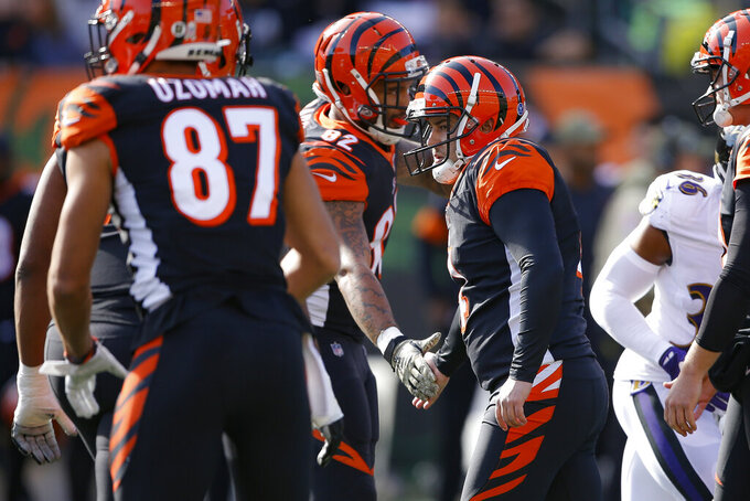 Cincinnati Bengals kicker Randy Bullock, center right, celebrates his field goal during the first half of NFL football game against the Baltimore Ravens, Sunday, Nov. 10, 2019, in Cincinnati. (AP Photo/Gary Landers)