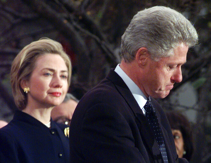 FILE - In this Dec. 19, 1998 file photo, first lady Hillary Rodham Clinton watches President Clinton pause as he thanks those Democratic members of the House of Representatives who voted against impeachment at the White House in Washington. (AP Photo/Susan Walsh, File)