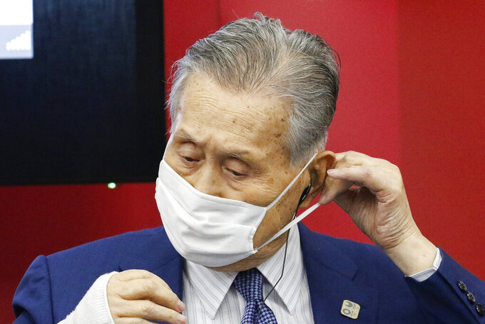 President of Tokyo 2020 Yoshiro Mori wears a face mask before he leaves a joint press conference between the International Olympic Committee (IOC) and Tokyo Organizing Committee of the Olympic and Paralympic Games (Tokyo 2020) Friday, Sept. 25, 2020, in Tokyo. (Rodrigo Reyes Marin/Pool Photo via AP)