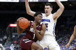 Missouri State's Keandre Cook (1) heads to the basket past Indiana State's Jake LaRavia (35) during the second half of an NCAA college basketball game in the quarterfinal round of the Missouri Valley Conference men's tournament Friday, March 6, 2020, in St. Louis. (AP Photo/Jeff Roberson)