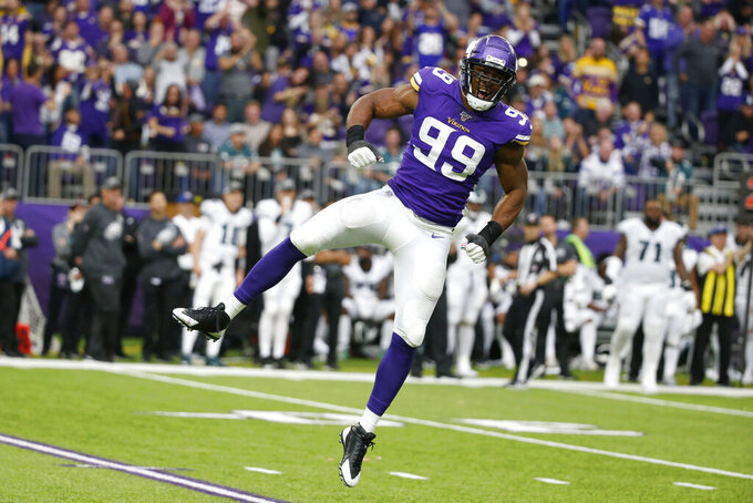 Minnesota Vikings defensive end Danielle Hunter celebrates after sacking Philadelphia Eagles quarterback Carson Wentz during the second half of an NFL football game, Sunday, Oct. 13, 2019, in Minneapolis. (AP Photo/Bruce Kluckhohn)