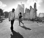 FILE - In this May 19, 1980, photo, people walk past ruins in the Culmer section of Miami after rioting over the acquittal of four police officers charged with the 1979 beating death of Arthur McDuffie, a black motorcyclist. When future Virginia Gov. Ralph Northam and future Attorney General Mark Herring admitted dressing up in blackface in the 1980s racial stereotypes and racist imagery in popular culture seemed to be everywhere. There also was racial unrest and historic elections of black mayors. (AP Photo/Kathy Willens, File)
