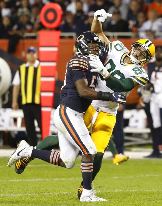 Chicago Bears' Roquan Smith is called for pass interference on Green Bay Packers' Jimmy Graham during the second half of an NFL football game Thursday, Sept. 5, 2019, in Chicago. (AP Photo/Charles Rex Arbogast)