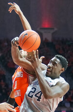 Penn State' forward Mike Watkins (24) and Illinois guard Alan Griffin (0) vie for the ball during the first half of an NCAA college basketball game in Champaign, Ill., Saturday, Feb. 23, 2019.(AP Photo/Robin Scholz)