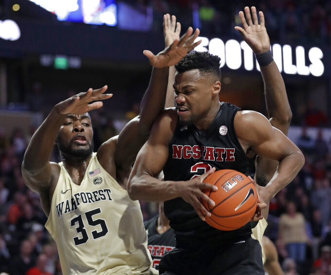 North Carolina State's Torin Dorn (2) drives against Wake Forest's Ikenna Smart (35) during the second half of an NCAA college basketball game in Winston-Salem, N.C., Tuesday, Jan. 15, 2019. (AP Photo/Chuck Burton)