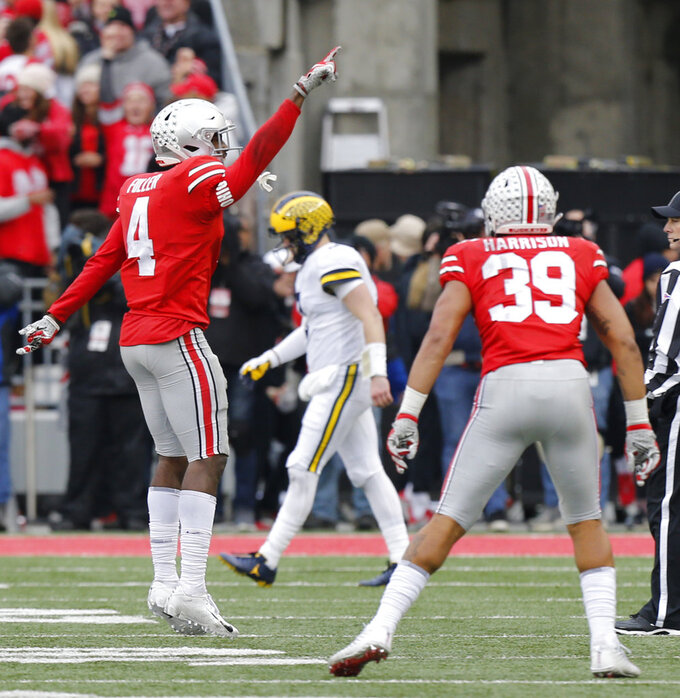 Ohio State defensive back Jordan Fuller, left, celebrates after making an interception against Michigan during the second half of an NCAA college football game Saturday, Nov. 24, 2018, in Columbus, Ohio. Ohio State beat Michigan 62-39. (AP Photo/Jay LaPrete)