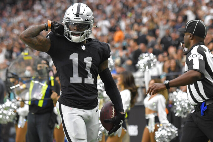 Las Vegas Raiders wide receiver Henry Ruggs III (11) celebrates after a catch against the Miami Dolphins during the first half of an NFL football game, Sunday, Sept. 26, 2021, in Las Vegas. (AP Photo/David Becker)