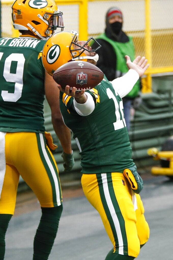 Green Bay Packers' Aaron Rodgers celebrates his touchdown run during the first half of an NFL football game against the Jacksonville Jaguars Sunday, Nov. 15, 2020, in Green Bay, Wis. (AP Photo/Matt Ludtke)