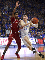 Kentucky's Tyler Herro (14) drives near Arkansas' Isaiah Joe (1) during the first half of an NCAA college basketball game in Lexington, Ky., Tuesday, Feb. 26, 2019. (AP Photo/James Crisp)