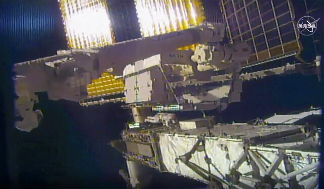 This photo provided by NASA shows NASA astronaut Chris Cassidy and NASA Flight Engineer Bob Behnken during a spacewalk outside the International Space Station on Friday, June 26, 2020.  Cassidy and Behnken, are conducting the first of at least four spacewalks to replace the last bunch of old station batteries. (NASA via AP)