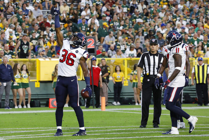 Houston Texans running back Damarea Crockett celebrates after rushing for a touchdown against the Green Bay Packers during the first half of an NFL preseason football game Thursday, Aug. 8, 2019, in Green Bay, Wis. (AP Photo/Mike Roemer)