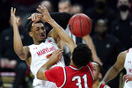 Maryland guard Aaron Wiggins, center, is fouled by Ohio State forward Seth Towns (31) during the first half of an NCAA college basketball game, Monday, Feb. 8, 2021, in College Park, Md. (AP Photo/Julio Cortez)