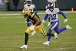 Green Bay Packers' Allen Lazard breaks away from Los Angeles Rams' Jordan Fuller (32) to score on a 58-yard touchdown run during the second half of an NFL divisional playoff football game Saturday, Jan. 16, 2021, in Green Bay, Wis. (AP Photo/Morry Gash)